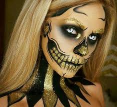 gold glitter skull day of the dead makeup idea for women perfect look for parties