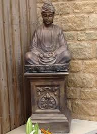 buddha of light on an ornate plinth