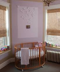 modern girls nursery with a circular crib