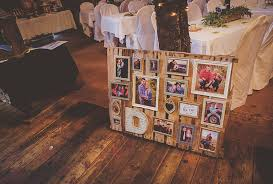 an old wood pallet serves as a photo board