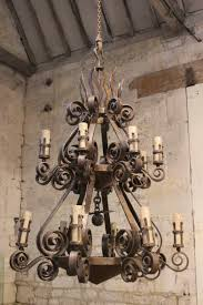 rod iron lighting. Two Tiered Wrought Iron Chandelier With Candles Majestic Chandeliers Create Rustic Feel Rod Light Fixtures. Lighting L