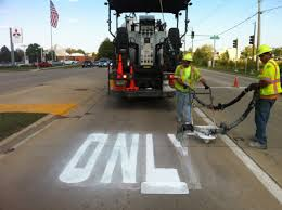 image of roadsafe employees painting a turn lane