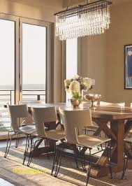 beautiful dining room decor ideas with brown wall paint color and modern crystal pendant light
