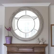white washed round window mirror