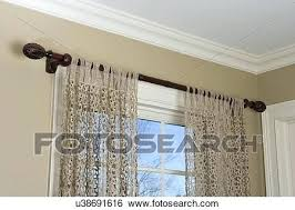 curtain top treatments stock image window treatments lace tab top curtains dark stained wood curtain rod
