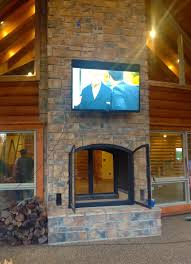 custom see through wood burning indoor outdoor fireplace