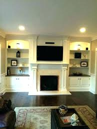 wall units with fireplace and tv cabet built in livg