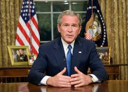 president in oval office. president george w bush delivers an address to the nation from oval office in