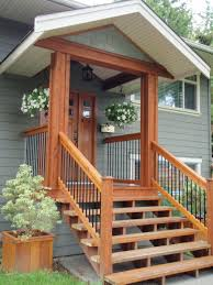 like it ... very small porch then simple wood stairs. I wonder if we could  figure out a small overhang like this on the back of our house that wo