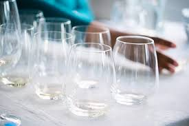 a group of stemless wineglasses on a table