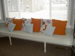 Decorations:Small Window Seating Design With Floral Theme Idea Fashionable  White And Yellow Cushions Over