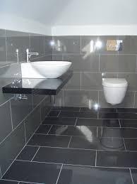 black granite washbasin sehlving stainless steel faucet head gray ceramic backsplash tile toilet bidet white wall