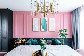 the picture frame moulding feels right at home in this modern victorian setting it creates an added dimension to the pink wall while serving to highlight