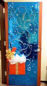 office door decoration christmas theme | This is a photo of a decorated door .