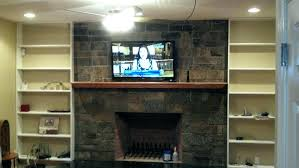 how to hide tv wires over brick fireplace mounted above fireplace where to put components full how to hide tv wires over brick fireplace