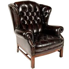 sinlgle vintage tufted leather wingback chair for