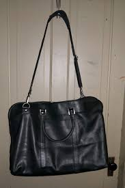 my awesome marc new york leather duffel w detachable strap i received for review from wilsons leather i have used this on several trips recently