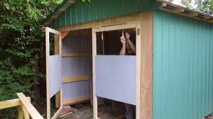 i used a bar clamp and some wooden spacers to clamp the doors in the right place before ing the hinges onto the shed