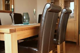 the gorgeous scroll back of the an full leather chair the ultimate in quality at a sensible