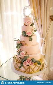 Beautiful Wedding Cake Decorated With Flowers Pink Color Of Cake