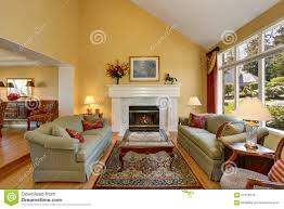 Yellow Walls Living Room Interior Decor Brilliant Living Room With Green Sofas And Yellow Walls Stock