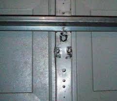 my garage door bracket which connects the garage door arm to the garage door ripped out of the garage door