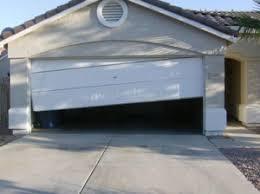 fixing garage doorGarage Door Repair Tucson AZ  Locally OwnedOperated Since 1999