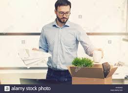 Job Loss Fired Man Putting His Belongings In Cardboard Box Stock