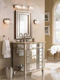 an elegant mirrored bathroom vanity with crystal sconces and bathbar
