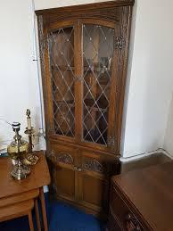 beautiful vine old charm oak double door corner cabinet