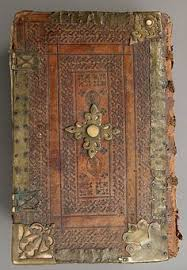 rare book with leather metal embossed book cover