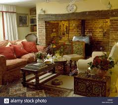 Peach Living Room Inlaid Chest Beside Armchair In Cottage Living Room With Peach