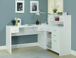 l shape white wooden desk with many drawers and shelves on the bottom combined with shelf on the middle of small drawers above the top