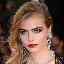 cara proves red works even when she s breaking all those rules by working it with heavy eye makeup too