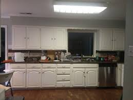 Traditional travertine floor enclosed kitchen idea in Newark with paneled  appliances, an undermount sink,