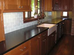 white kitchen backsplash subway tile natural maple cabinet with dark countertops