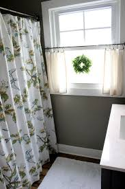 I love the little wreath and the neutral airy curtains that allow so much  light through  Bathroom Window ...