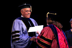 fordham notes graduate school of social service holds diploma  peter vaughan ph d dean of gss