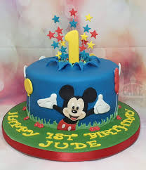 mickey mouse cake and disney cupcakes