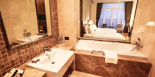 45 square meters deluxe room strokes in a modern style of wood marble and a glass window with a see through bath room from the bed