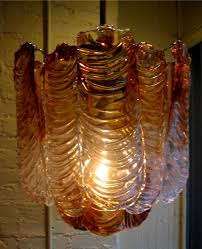 and clear murano glass pendants abstractly shaped as leaves the pendants measure about 5 x 14 and the entire lamp measures 17 h x 15 d