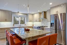 Gorgeous Kitchen Design Features Ivory Kitchen Cabinets Flanking