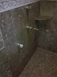polished emperador brown sudbury marble shower walls overall view