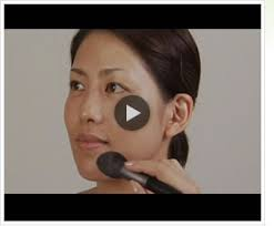 this video shows how to apply base makeup with a face powder brush that can hold lots of powder