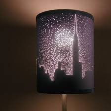 Here is a cool Idea for the DIYers that like to do projects using lighting!  This example uses a paper lampshade with a city skyline design put onto it  using ...