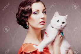 Cat Hair Style fashion model with make up hair style and jewelry holding white 8911 by stevesalt.us