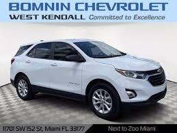 2020 chevrolet equinox premier 22/28 city/highway mpg lifetime limited power train warranty, only 8.7% sales tax, save hundreds!, alloy wheels, audio package, backup camera, bluetooth, climate package, leather seats, navigation system, power mirror package, power package, premium audio package, premium sound package, premium wheels, rear climate package, remote start, awd. 2020 Chevrolet Equinox Summit White In Miami Stock F293300c
