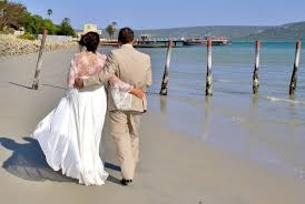the advantages and disadvantages of marriage pairedlife a bride and groom walk along the beach after a wedding ceremony 50% of