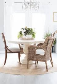 oversized wicker furniture is perfect for a laid back light and airy dining room like this