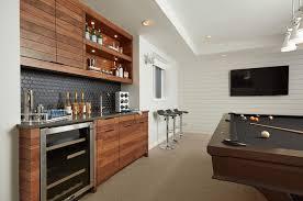excellent home bar design with dark wooden modern bar cabinet along black tile pattern backsplash also agreeable home bar design